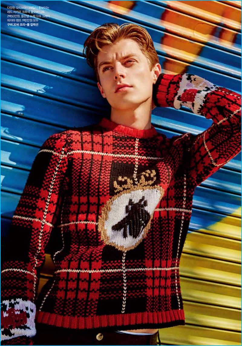 Janis Ancens is front and center in quite the plaid sweater number from Gucci.