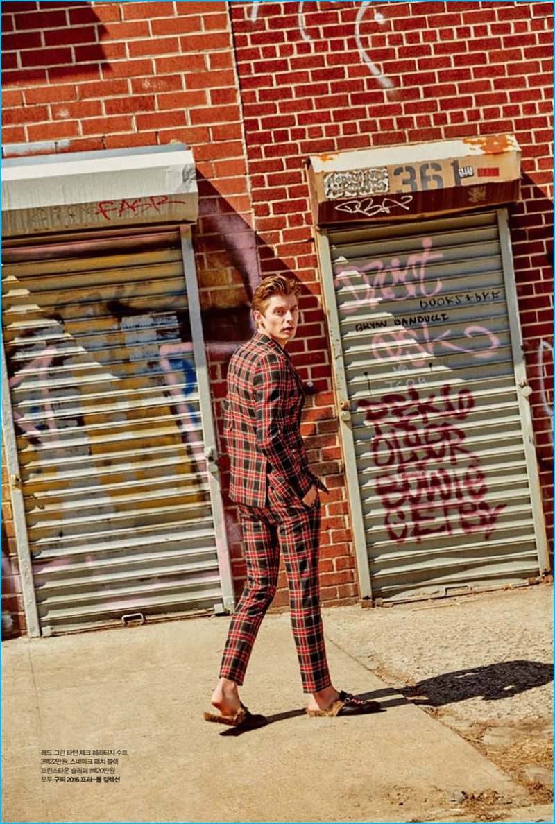 Janis Ancens ventures outdoors in a plaid suit from Gucci.