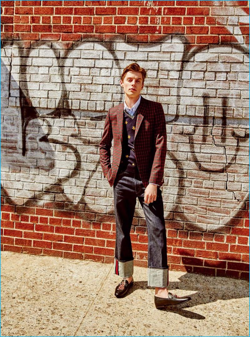 Going preppy, Janis Ancens sports wide-cut denim jeans with a plaid blazer from Gucci.