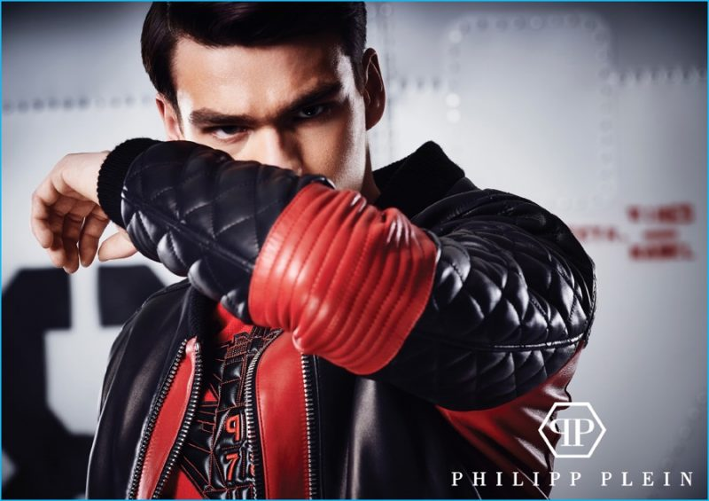 Filip Hrivnak rocks a red and black leather moto jacket from Philipp Plein's pre-fall 2016 collection.