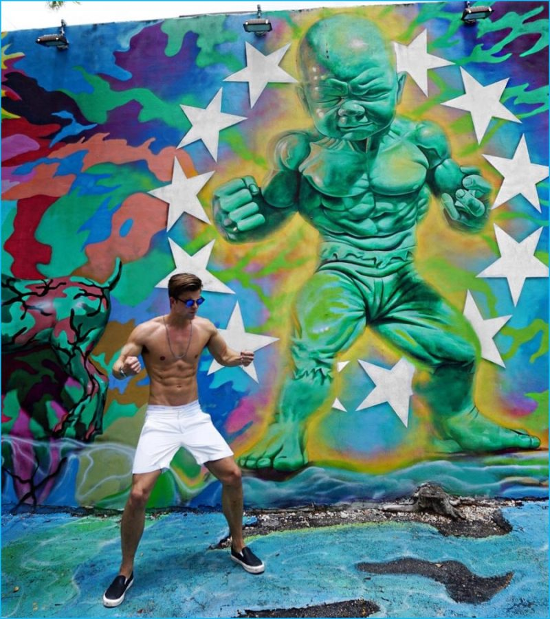 River Viiperi is Miami bound, posing against the Wynwood Walls.