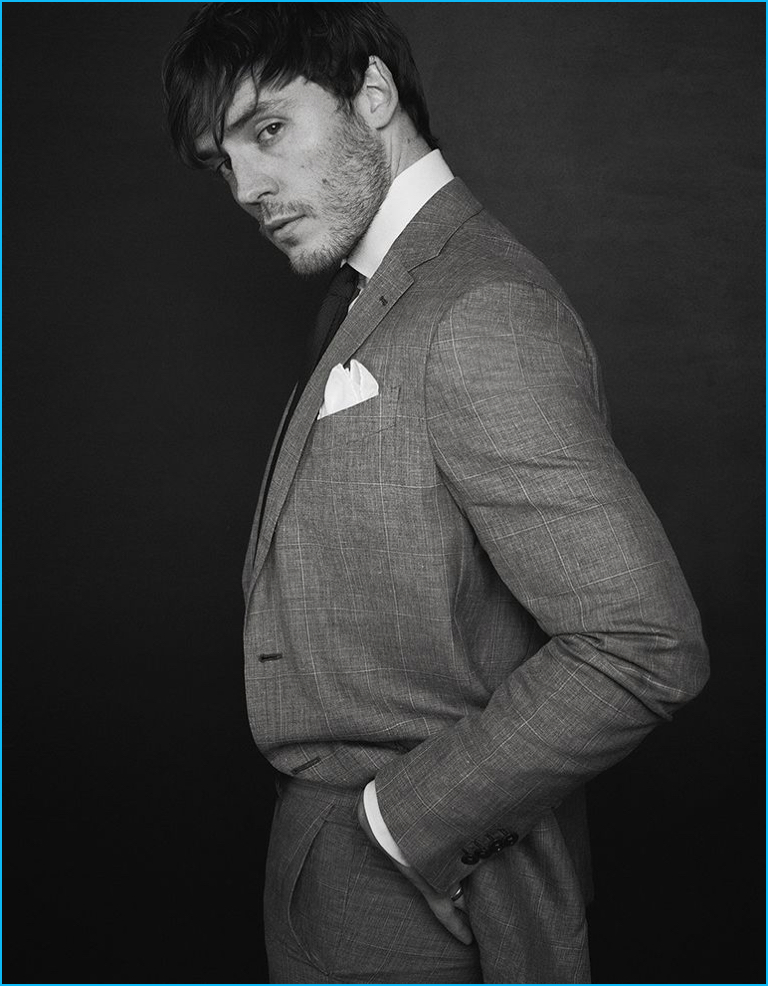Sam Claflin dons a sharp tailored suit from Ermenegildo Zegna Made to Measure.