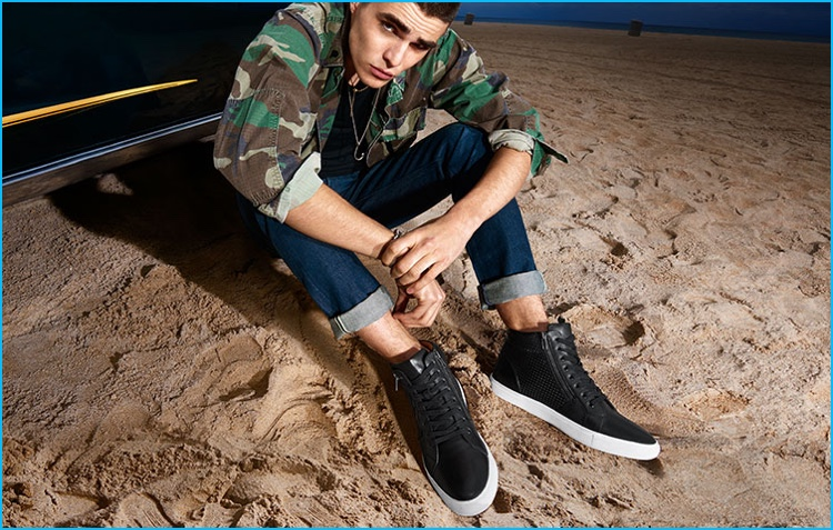 Diego Villarreal pictured in Steve Madden high-top sneakers.