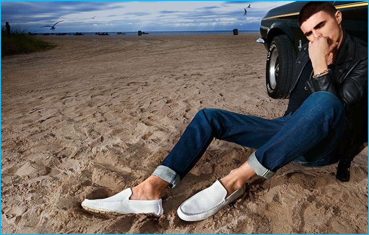 Diego Villarreal takes to the beach for Steve Madden, wearing white loafers.