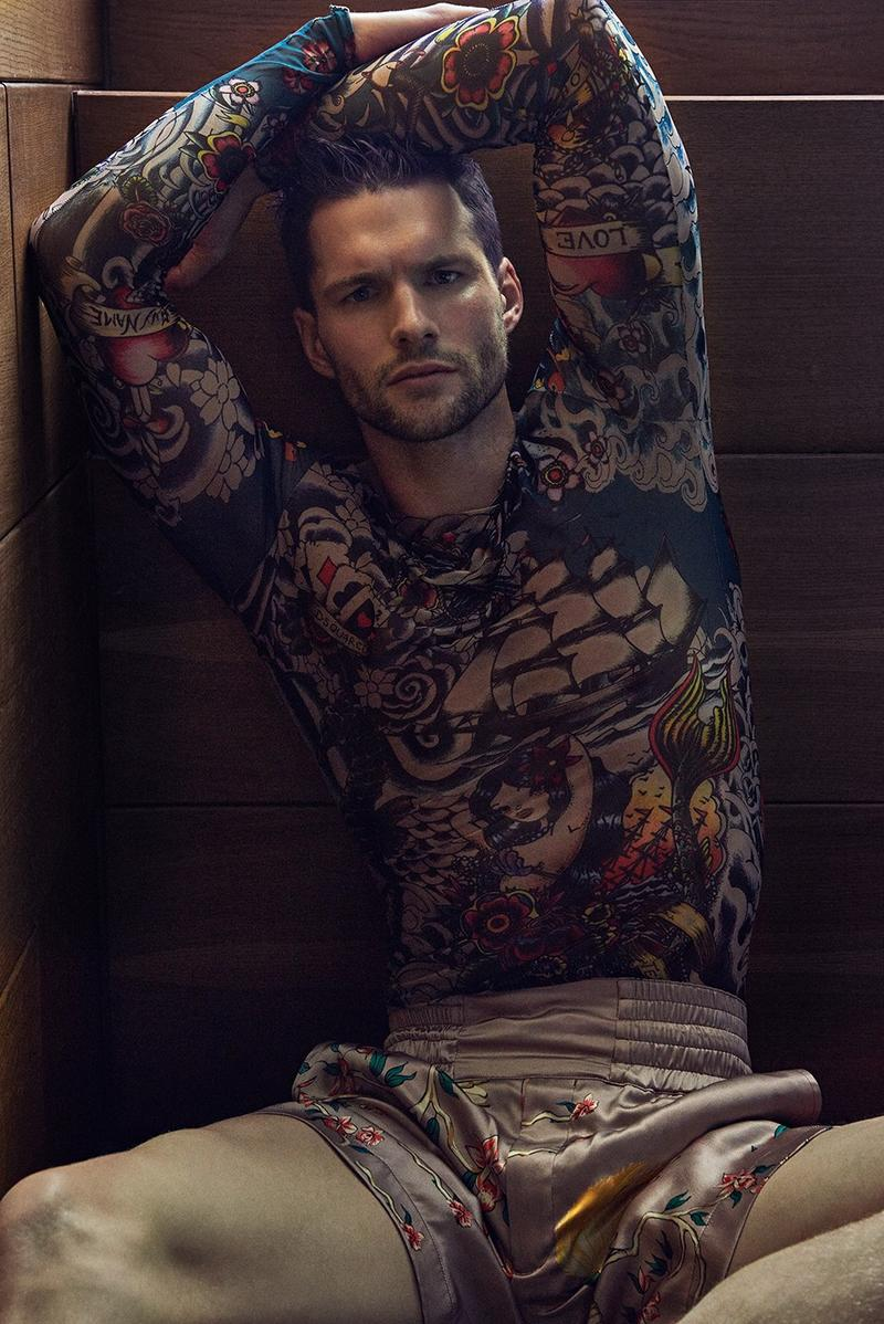 Tomas Skoloudik rocks a tattoo long-sleeve top from Dsquared2.