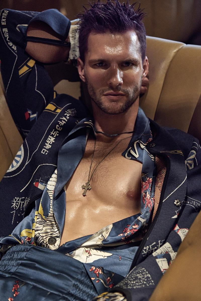 Tomas Skoloudik dons a silk patterned look from Louis Vuitton, complemented by a Loewe jacket.