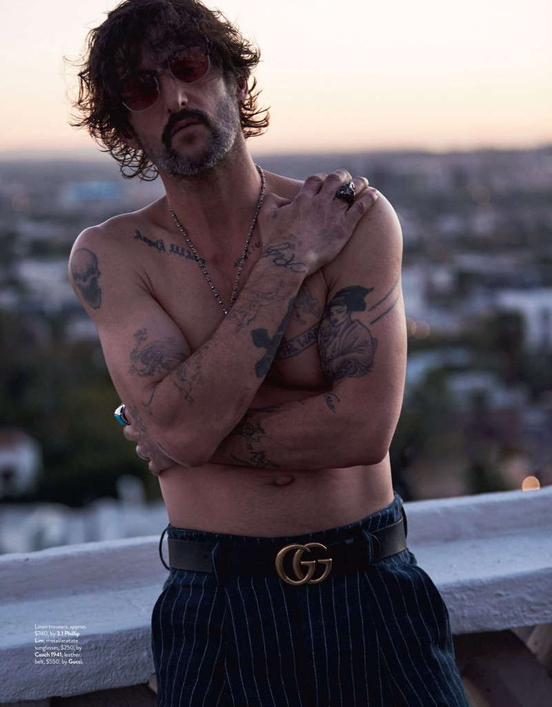 23724ac72e1918 Tony Ward shows off his tattoos in a shirtless ensemble that features 3.1  Phillip Lim pinstripe