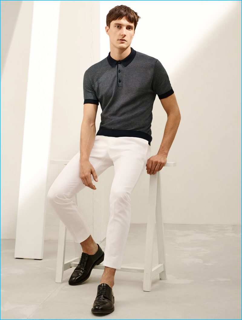 Charlie Timms is front and center in a polo shirt, white trousers and antik leather bluchers from Zara Man.
