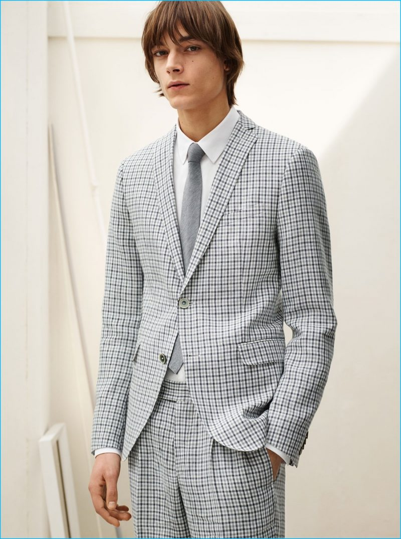 Timur Muharemovic dons a plaid linen suit, textured weave shirt and melange circular knit tie from Zara Man.