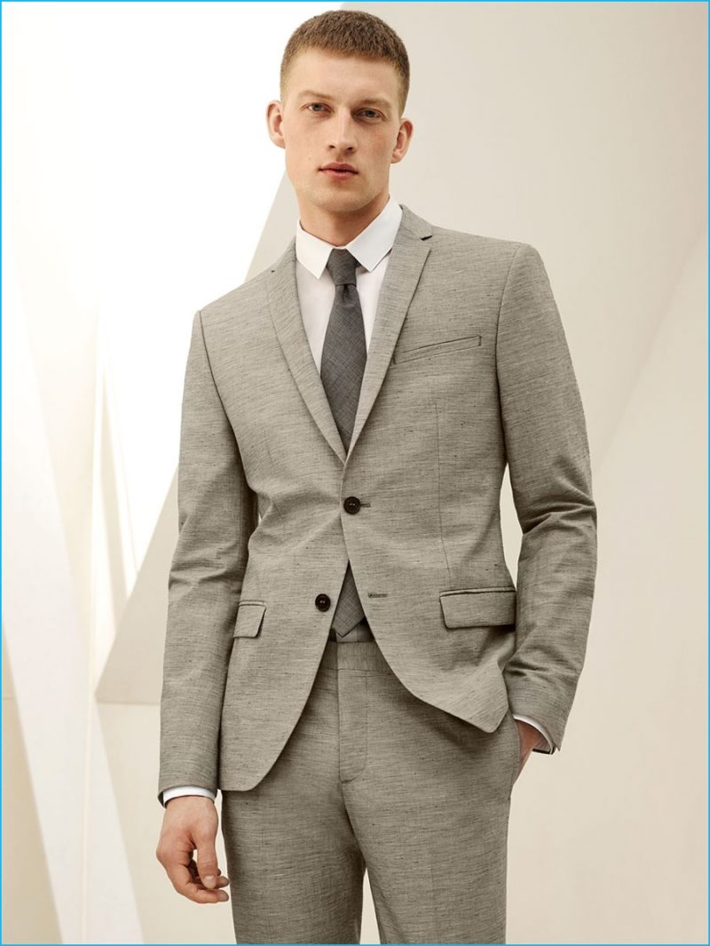 Bastian Thiery embraces neutrals in a houndstooth suit, striped shirt and matte narrow tie from Zara Man.