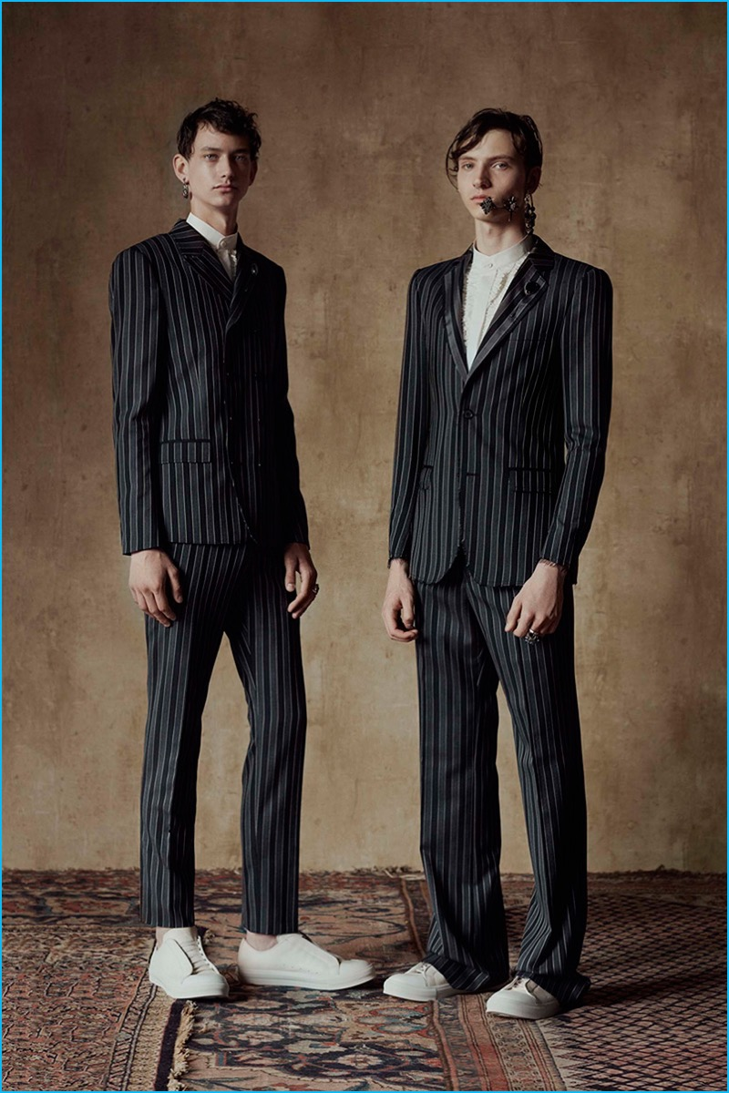 Alexander McQueen juxtaposes its dark striped suiting with white sneakers for spring-summer 2017.