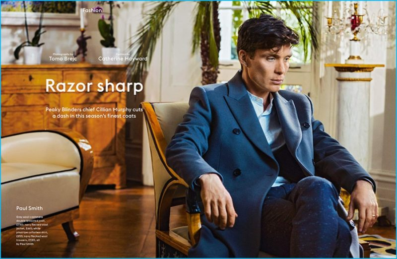 Cillian Murphy dons a navy double-breasted coat from Paul Smith.