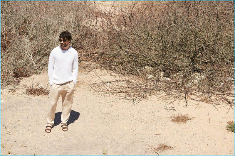 Cedric Bihr wears Club Monaco rib stitch roll neck, Delave beach pants and ancient Greek Geneos sandals.