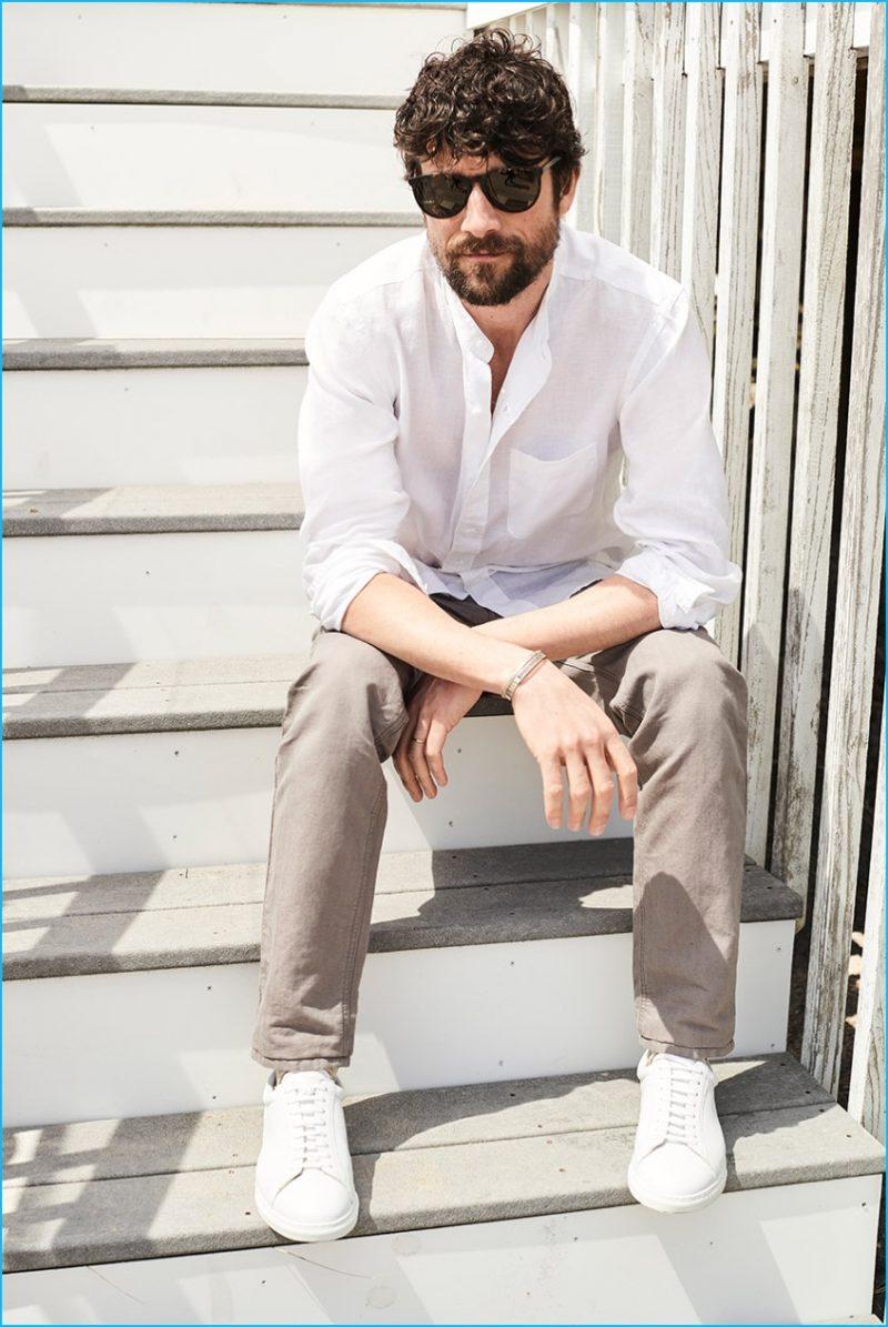 Cedric Bihr wears Club Monaco slim-fit band-collar linen shirt, 5-pocket washed herringbone pants and white sneakers.