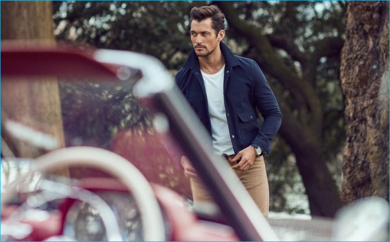 David Gandy embraces a fitted look of classics, sporting a Harrington jacket over a casual crewneck t-shirt.