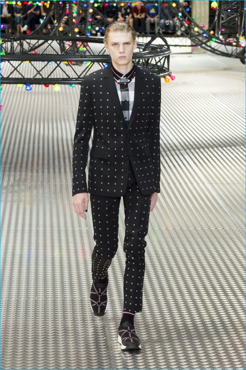 Dior Homme updates a trim black suit with all-over eyelets.