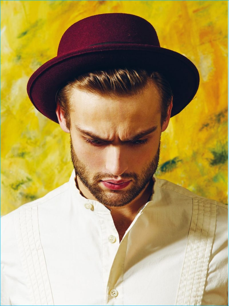 Donning a felt hat, Douglas Booth is photographed by Ram Shergill for The Protagonist.