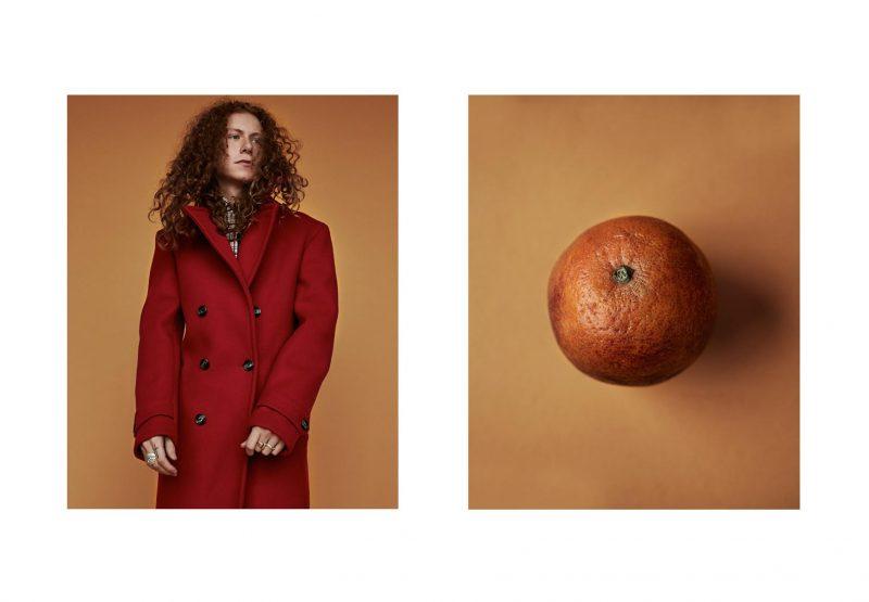 Mcabe wears double-breasted coat Salvatore Ferragamo.