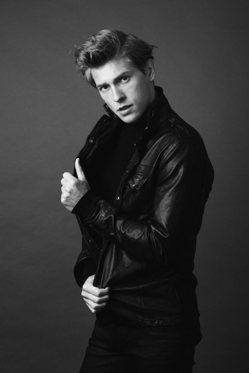 William wears turtleneck Hugo Boss, pants Calvin Klein Jeans and leather jacket Diesel.