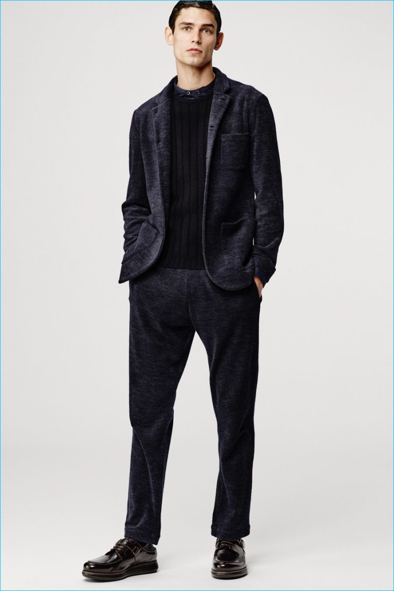 Arthur Gosse dons a dark look from Giorgio Armani's fall-winter 2016 collection.