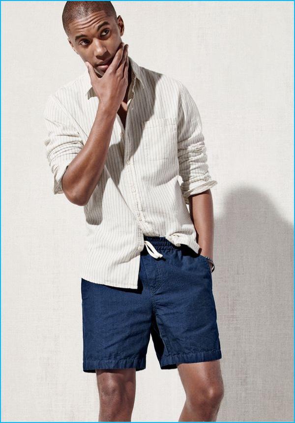 67e4b756a785 Claudio Monteiro models a button-down shirt with J.Crew dock shorts.