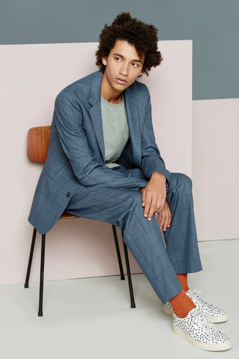 Jackson Hale is front and center in a grey Paul Smith windowpane suit.