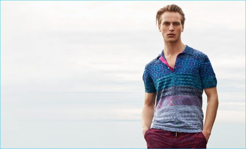 Jules Raynal wears striped-knit cotton polo shirt by Missoni. Clay swim shorts by Thorsun.