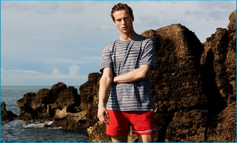 Jules Raynal wears multi-stripe cotton T-shirt by Missoni. Asymmetric-stripe swim shorts by Dan Ward.