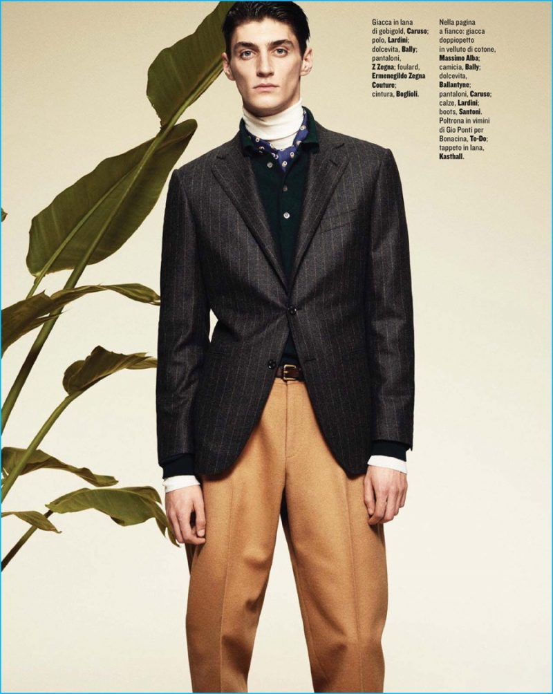 Mihai Bran embraces tailored separates for fall, donning Z Zegna trousers with a pinstripe Caruso jacket.