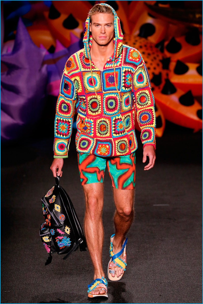 Moschino is festival ready with a psychedelic pullover and biking shorts.