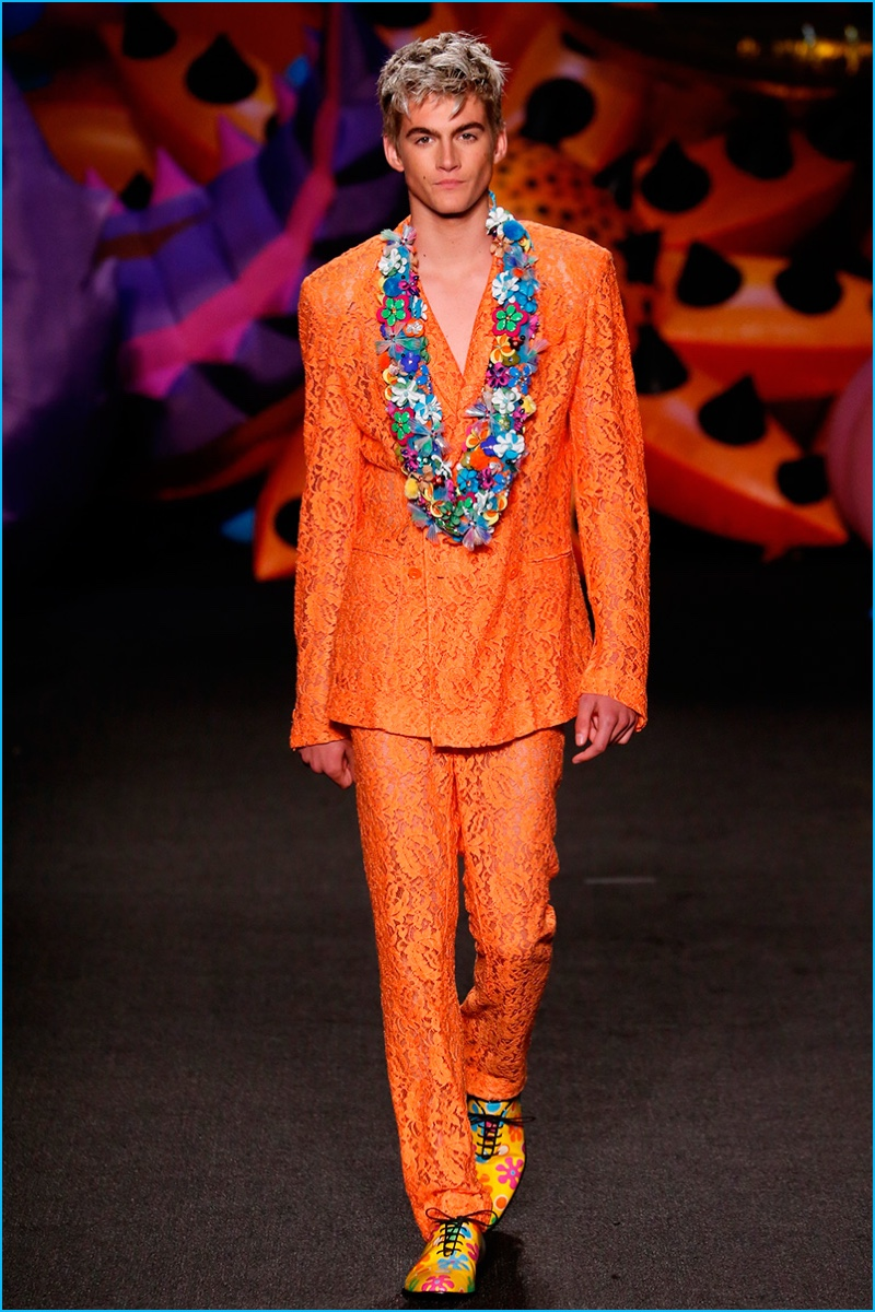 The son of Cindy Crawford, Presley Gerber has a standout moment in a bold orange Moschino suit.
