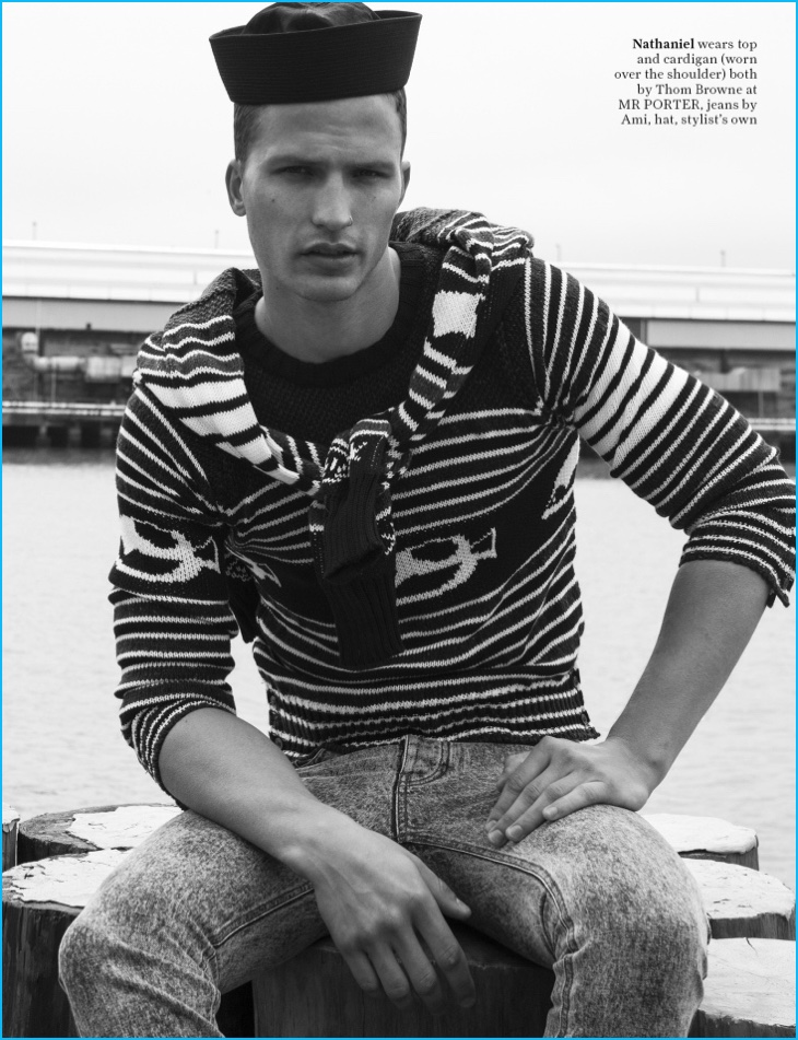 Remixing stripes, Nathaniel Visser dons a Thom Browne cardigan set with AMI jeans.
