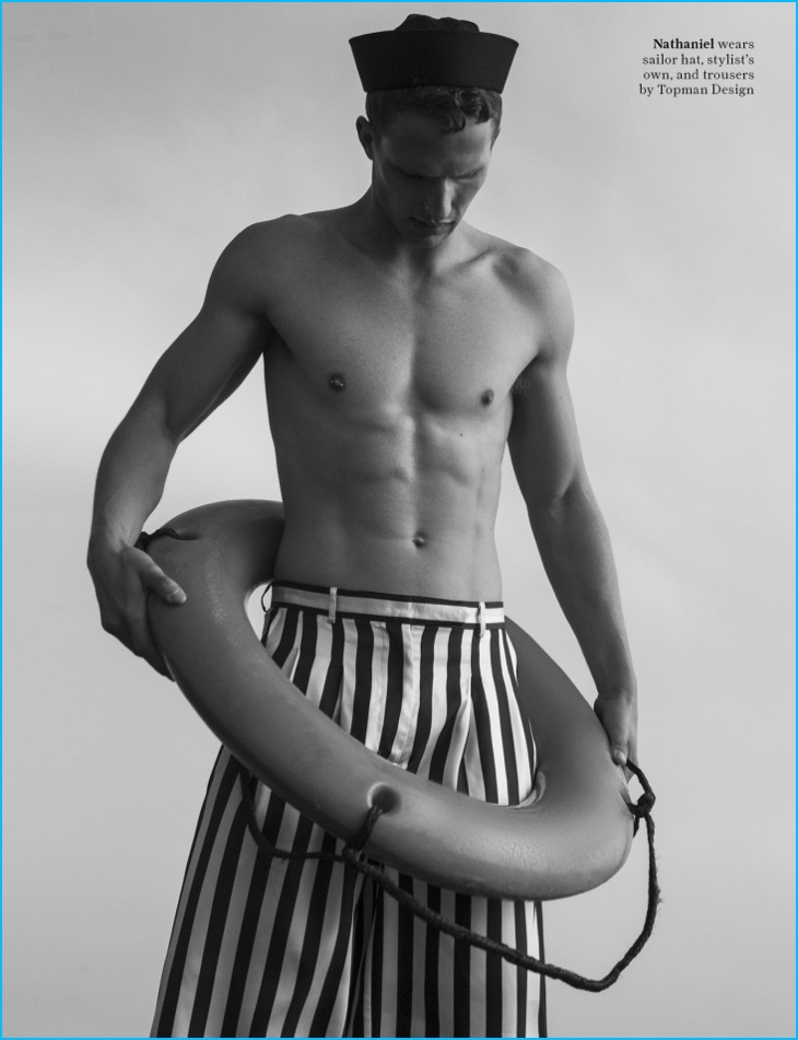 Nathaniel Visser dons wide-cut striped trousers from Topman Design.