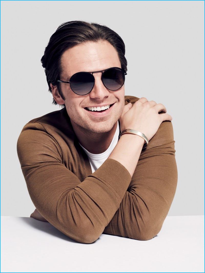 7cfe49d4a5b Sebastian Stan is all smiles in Tom Ford sunglasses with a Burberry  cardigan and David Yurman