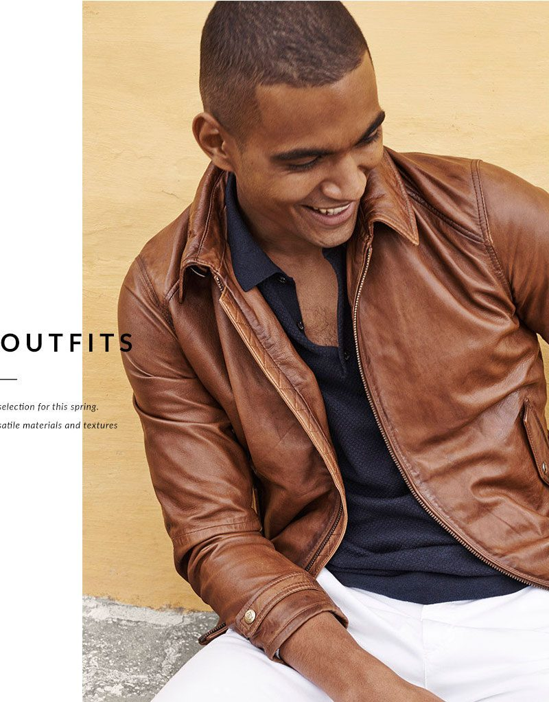 Terence Telle is all smiles in a brown leather jacket with a textured polo shirt, white pants and espadrilles from Massimo Dutti.