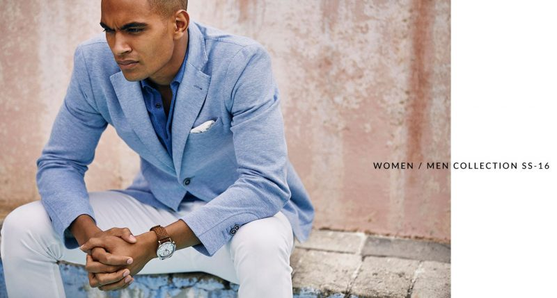 Terence Telle sports a summer look from Massimo Dutti, tackling a light blue jersey blazer with white pants.