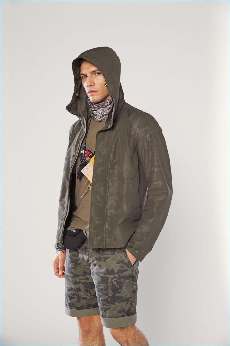 Woolrich John Rich & Bros. embraces camouflage for the season, turning out relaxed shorts and a water resistant jacket.