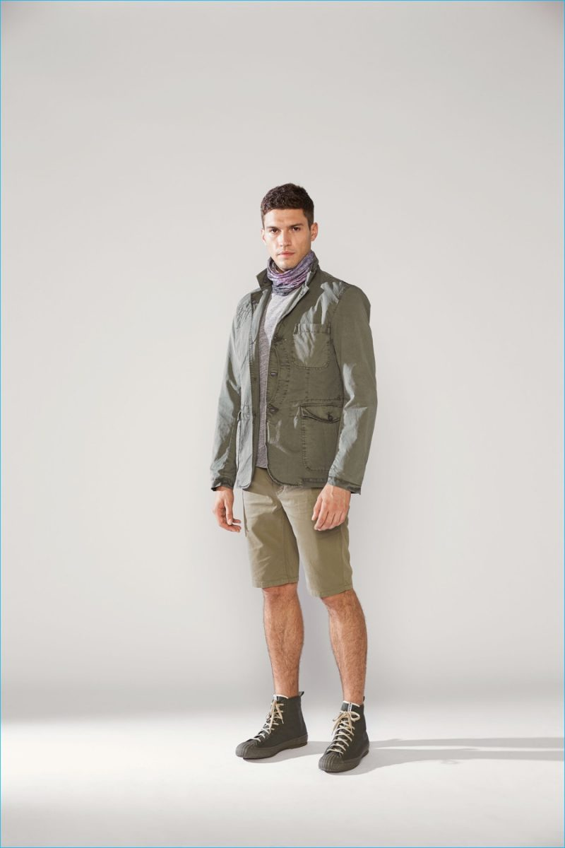 Woolrich John Rich & Bros. stands by monochromatic dressing with a casual green look.