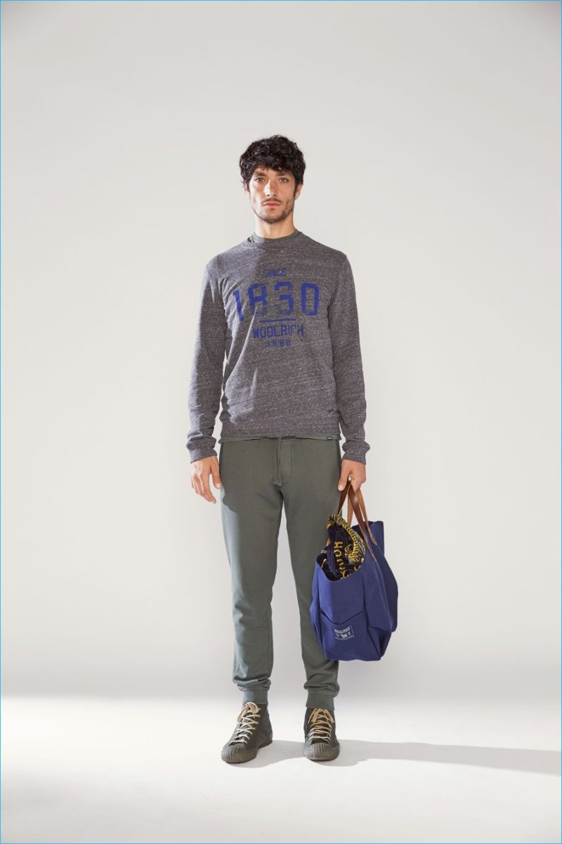 Woolrich John Rich & Bros. exudes rugged charm with laid-back joggers and a graphic pullover.