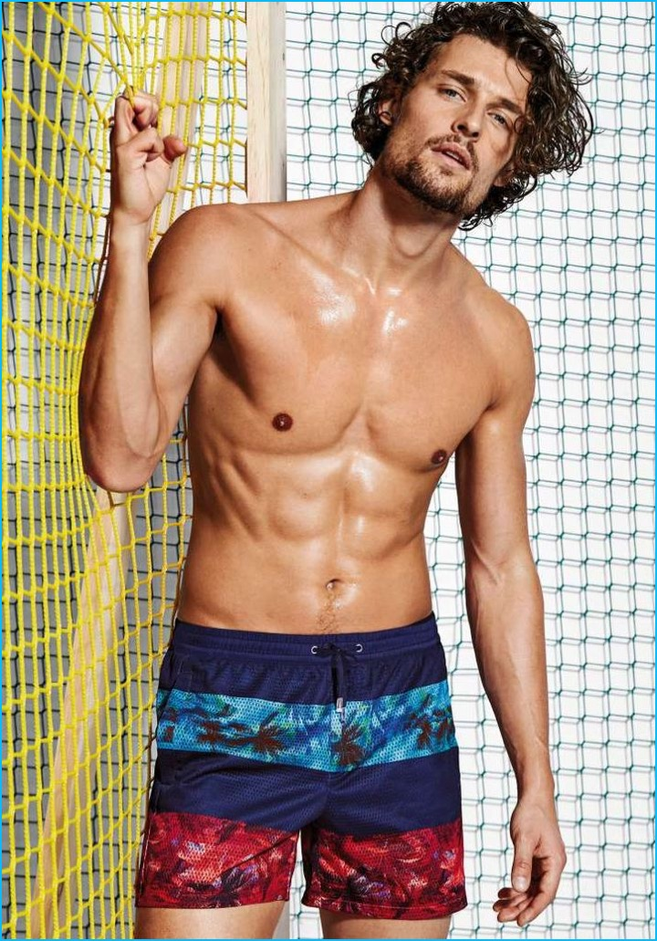 cf9b295efb061 Wouter Peelen is front and center in mesh striped swim shorts from  Calzedonia.