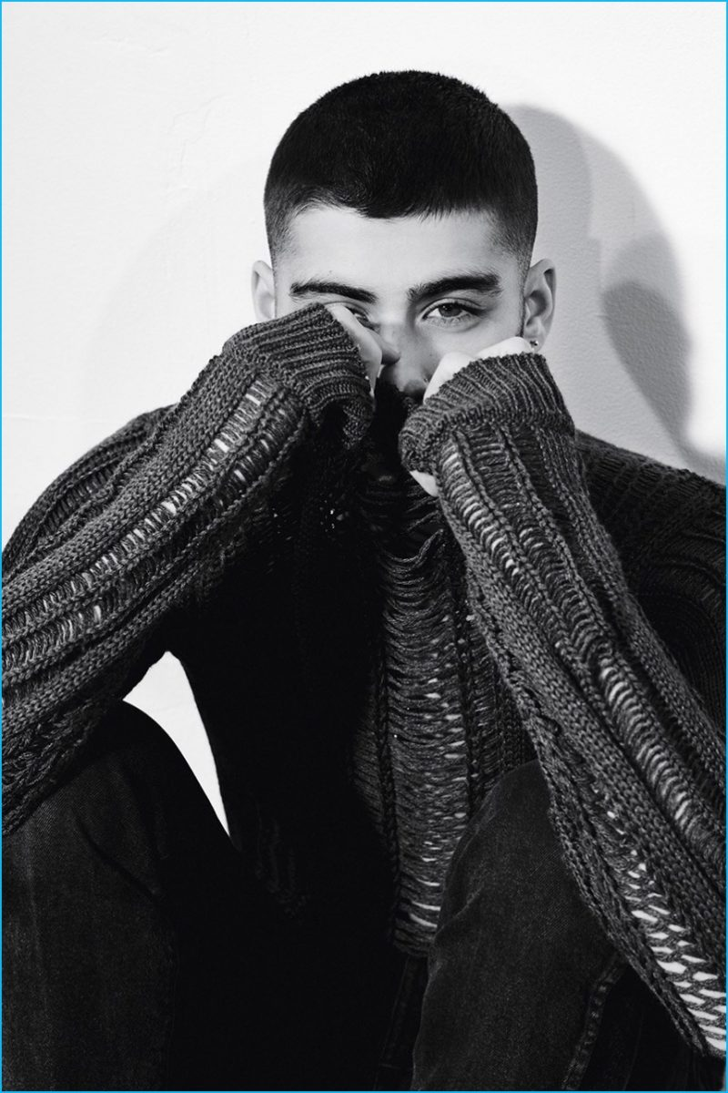 Zayn Malik pictured in a Louis Vuitton sweater with AG Jeans denim.