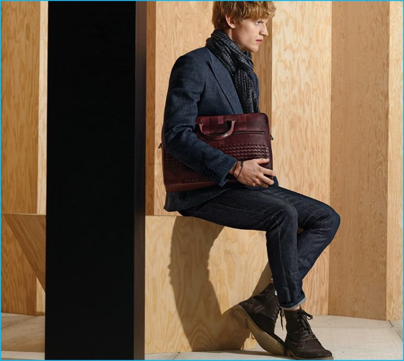 Smart blazers are paired with dark wash denim jeans for a contemporary look from Bottega Veneta's pre-fall 2016 men's collection.