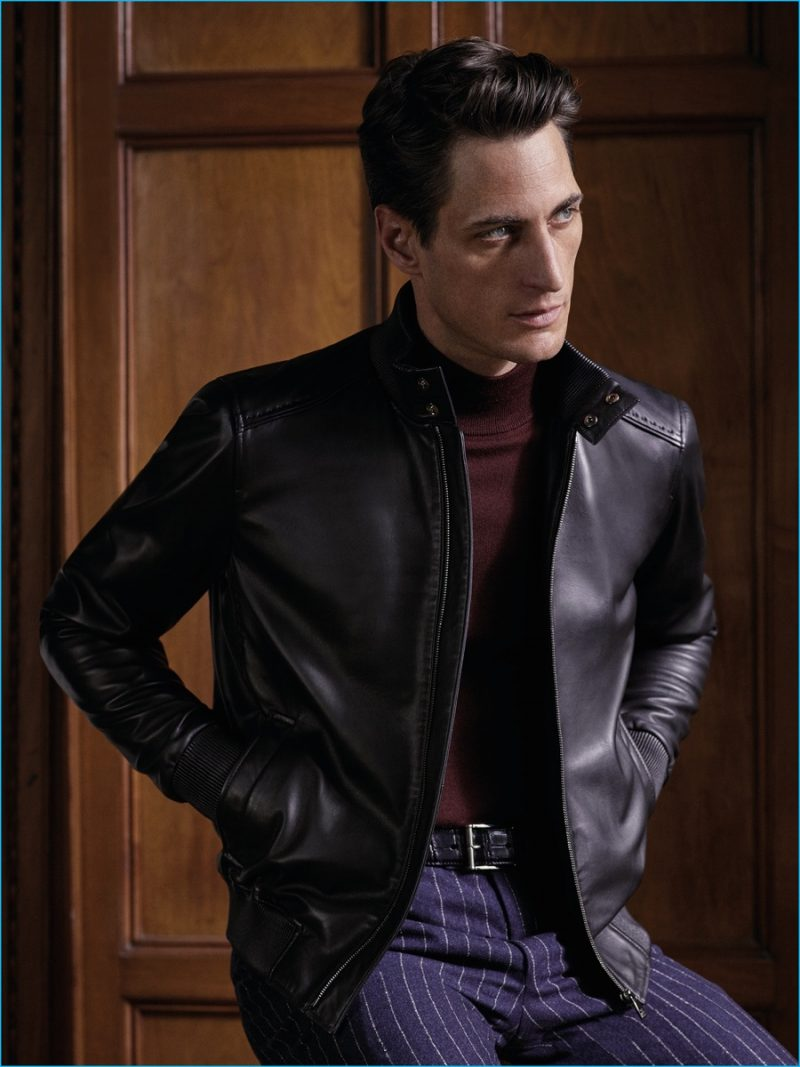 Axel Hermann sports a nappa leather jacket with pinstripe trousers from Corneliani's fall-winter 2016 collection.
