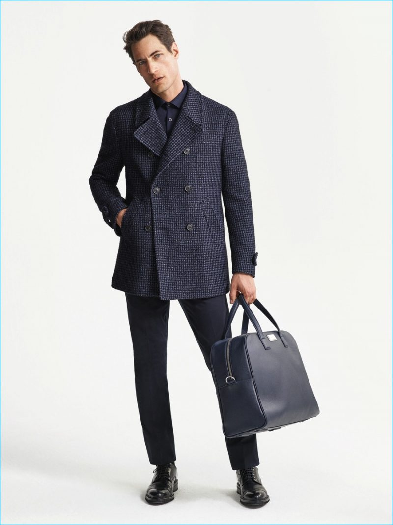 Axel Hermann sports a double-breasted coat from Corneliani's fall-winter 2016 collection.