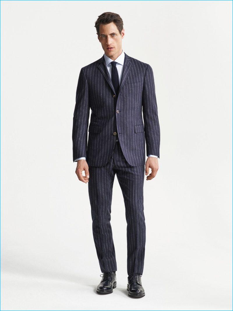 Axel Hermann wears a pinstripe flannel suit from Corneliani's fall-winter 2016 collection.