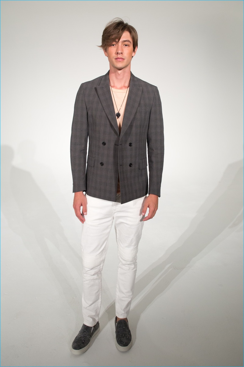 Classics such as the double-breasted jacket come together with casual statements like white jeans for David Naman's spring-summer 2017 collection.