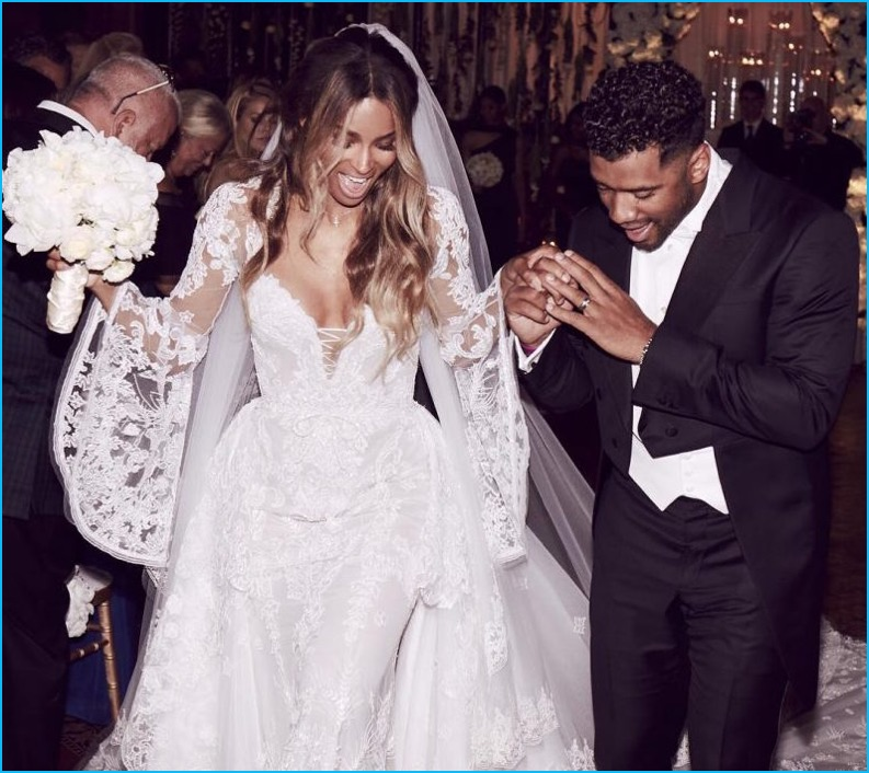 Donning a dashing Giorgio Armani Made to Measure number, Russell Wilson weds Ciara, who wore a Cavalli Couture wedding gown.