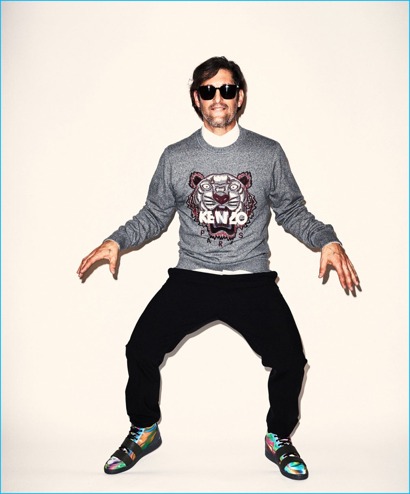 Tony Ward brings the quirky antics in a Kenzo tiger sweatshirt and trousers, paired with Puma McQ sneakers.