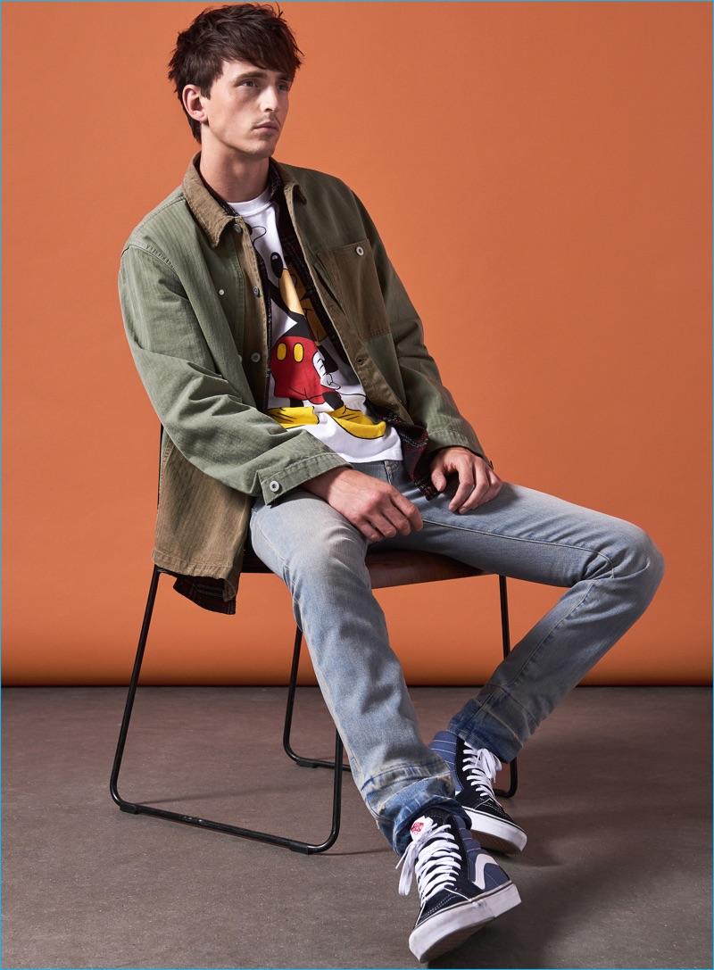 Alex Dunstan wears check shirt The Kooples, Mickey Mouse t-shirt Rokit, hi-top sneakers Vans, denim jeans and distressed jacket Maison Margiela.