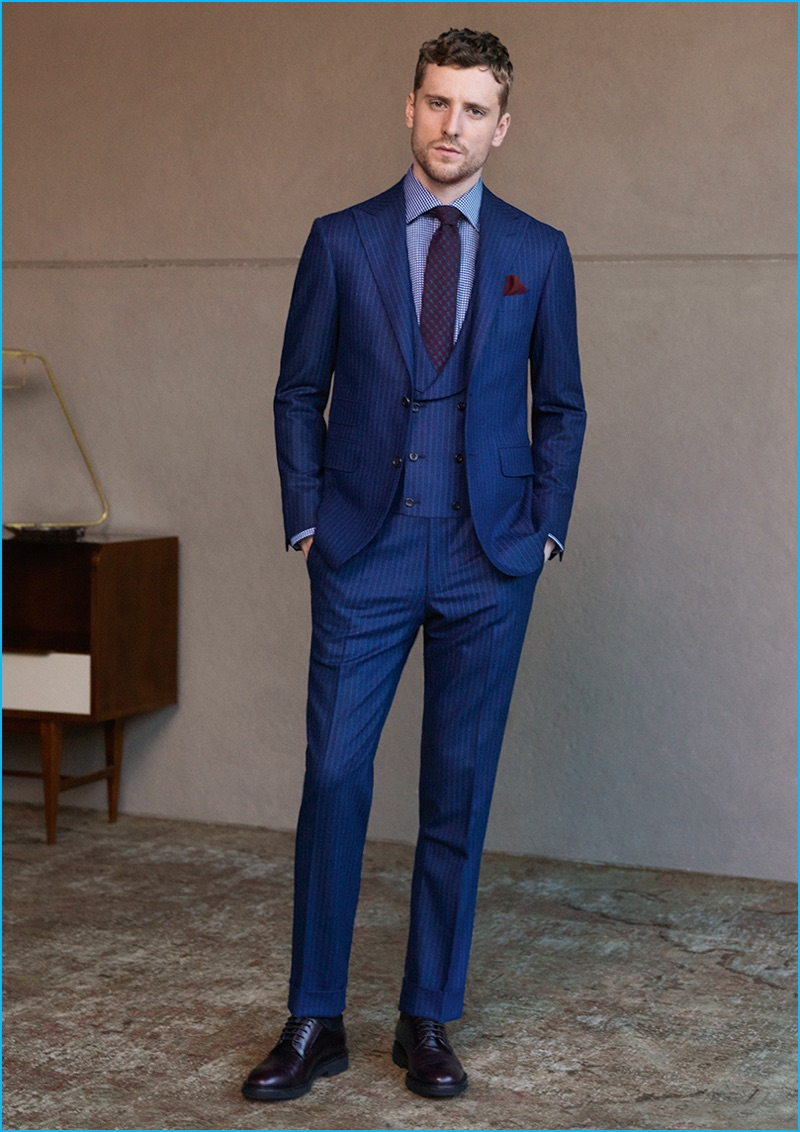 George Barnett dons a navy three-piece pinstripe suit from Canali's fall-winter 2016 collection.